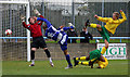 Dist:0.2km<br/>Goalmouth action at a Wingate and Finchley (blues) home game against rivals Waltham Abbey.  The shot went just wide and the game finished 1-1.  The buildings of Finchley Lido are just visible through the railings.