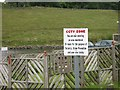 NS8467 : Sign beside the cycleway, Hillend by Richard Webb