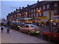 TQ2487 : Golders Green Road at dusk by David Howard