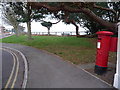 SZ0588 : Canford Cliffs: postbox № BH13 129, Cliff Drive by Chris Downer