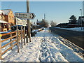TL1183 : Crusty snow on the footpath, Great Gidding by Michael Trolove