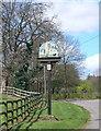 TL1965 : Diddington Village Sign by Eirian Evans