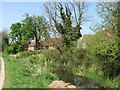 SP8911 : Wendover Arm: Houses line the North Bank of the Canal at Aston Clinton by Chris Reynolds