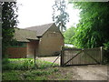 SP9008 : Entrance to a modern building adjoining the Ridgeway at Chivery by Chris Reynolds