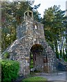 Dist:0.2km<br/>This 18th century gateway to the Auld Aisle graveyard is surmounted by a watchhouse and a belfry. The watchhouse, reached by steps built into the arch of the gateway, was intended to provide shelter to people guarding newly buried people against grave robbers. In the early 19th century there was a great shortage of corpses for anatomists  and grave robbers, or resurrection men as they were called, made a living by stealing the newly dead and buried. The bell in the belfry may have been used to call for assistance or it may have housed the deid or mort bell which was tolled at funerals.