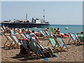 TQ3103 : Deckchairs and sunbathers on a sunny Sunday, Brighton beach by David Hawgood