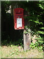 SY7685 : Owermoigne: postbox № DT2 162, Moreton Road by Chris Downer