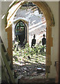 TG2504 : The church of St Wandregesilius - view through south doorway by Evelyn Simak
