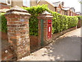 ST8906 : Blandford Forum: postbox № DT11 137, St. Leonard�s Avenue by Chris Downer