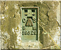 ST6066 : 2009 : Flush plate on Maes Knoll trig point by Maurice Pullin