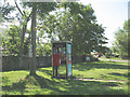 NT9529 : Payphone and post box at Akeld by Stephen Craven