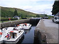 NN2896 : Laggan Lock with boats in by Nicholas Mutton