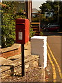 SY3392 : Lyme Regis: postbox № DT7 34, Pound Road and glimpse of Golden Cap by Chris Downer