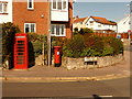 SY3492 : Lyme Regis: postbox № DT7 30 and phone, Anning Road by Chris Downer