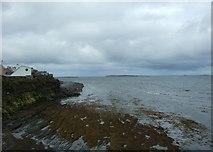 R0174 : Sea wall at Quilty by Simon Huguet