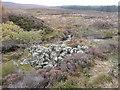 NN9349 : Heap of stones beside Balnaguard Burn by Russel Wills
