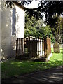 SU9006 : Fenced in tomb outside  St Andrew, Tangmere by Basher Eyre