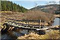 NN0662 : Dangerous footbridge over Abhainn Righ in Glen Righ by Steven Brown