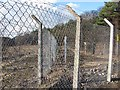 NS7964 : Fence, Inver  House Distillery by Richard Webb