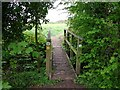 SP1953 : Footbridge on Monarch's Way footpath by David P Howard