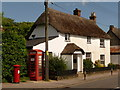 ST8211 : Shillingstone: cottage, postbox and phone box by Chris Downer