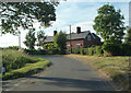 TF3164 : Cottage at Junction of Road to Claxby Puckacre by Tom Presland