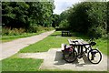 SX0875 : Picnic Tables at the End of the Camel Trail by Tony Atkin
