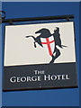 TQ7736 : The George Hotel sign by Oast House Archive
