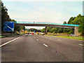 SJ7784 : M56, Ashley Hall Footbridge by David Dixon