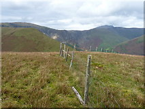 SH8516 : Fence on the summit of Foel Benddin by Richard Law