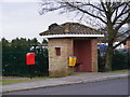 TM2952 : Parklands Postbox & Bus Shelter by Adrian Cable