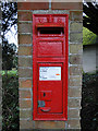 TM3395 : Victorian postbox in a brick pillar near Thwaite church by Adrian S Pye