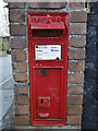 TF9813 : Victorian wall postbox number NR19 1923 by Adrian S Pye