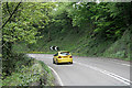 SK2573 : A car approaches a bend in the A623 by David Lally