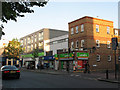 TQ3978 : Food shops on Woolwich Road by Stephen Craven