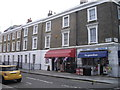TQ2978 : Shops in Ponsonby Place Pimlico by PAUL FARMER