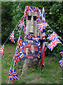 TL3762 : Wood sculpture ready for Royal Wedding Street Party by Julian Paren