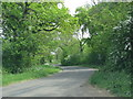 SP6338 : Road near Evershaw Farm by Sarah Charlesworth