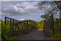 TQ3453 : Footbridge by Carl Ayling
