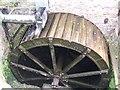 SJ9136 : Mosty Lea Mill - wheel in full flow by John M