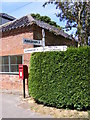 TG0329 : The Street Postbox &amp; Roadsign by Adrian Cable