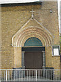 TQ3479 : Doorway of St Peter's church by Stephen Craven