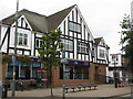 TQ4467 : Mock Tudorbethan estate agents, Station Square, Petts Wood, BR5 by Mike Quinn