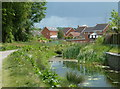 SK4478 : Chesterfield Canal and new houses, Renishaw by Andrew Hill