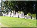 NZ2213 : Gravestones, The Church of All Saints' by Miss Steel