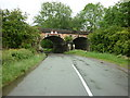 SK3858 : A rail bridge goes over the road and river on Back Lane by Ian S