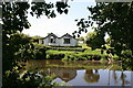 SJ4056 : Chalet on the River Dee by Jeff Buck