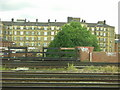 TQ3379 : Victorian flats, Bermondsey, from the train by Christopher Hilton