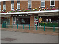 TM0938 : Parade of shops, Capel by Roger Jones