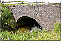 NJ5601 : Road bridge over the Dess burn by Alan Findlay
